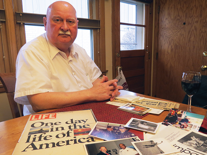 Henry Gralak is pictured at his kitchen table in Chicago with a copy of the LIFE magazine article in which he appeared during his service with the Chicago Police Department, photos from his tour of duty in Vietnam and other mementos from his years of duty.  (Photo: Karl J. Paloucek)