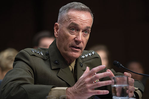 "Marine Corps Commandant Gen. Joseph Dunford Jr., testifies during his Senate Armed Services Committee confirmation hearing to become the Chairman of the Joint Chiefs of Staff, on Capitol Hill in Washington, Thursday, July 9, 2015. Dunford said Russia poses the greatest national security threat to the United States and that it would be ""reasonable"" to supply lethal arms to Ukrainians fighting against rebels backed by Moscow. (AP Photo/Cliff Owen)"
